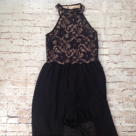 Romper with sheer maxi skirt around back